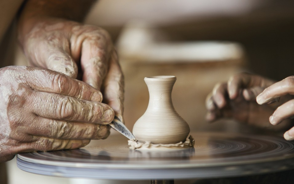 Closeup image ceramist man hands